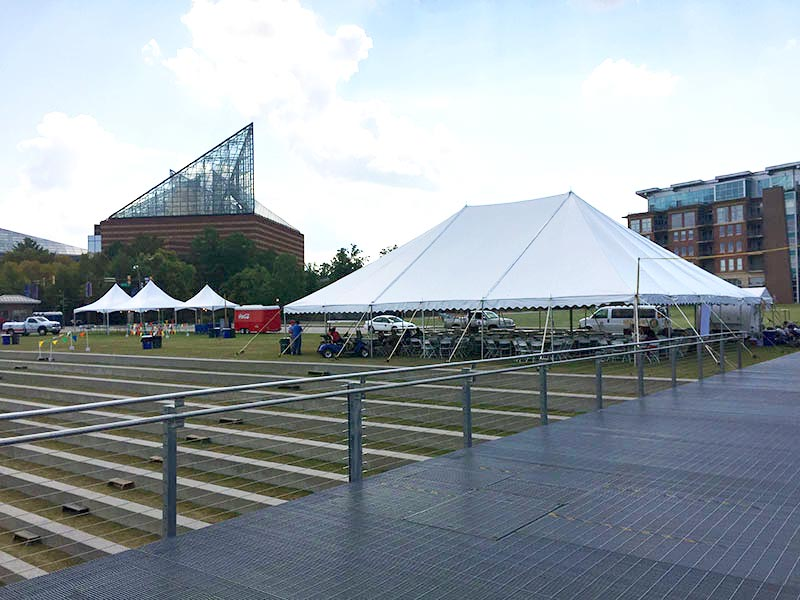 Tent manufacturers setting up for an event.