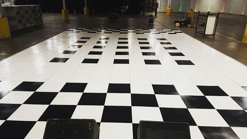 Tent manufacturers showing dance floor for upcoming event.